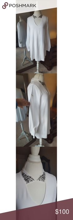 BCBG White Long Sleeve Dress Gorgeous dress! Slip underneath, slit arms, and pockets too! Button in the back of the neck for closure. All embellishments intact. Worn once for graduation. Dry cleaned. No flaws, in perfect condition! BCBG Dresses Long Sleeve
