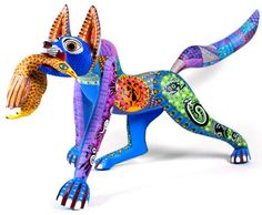 "Alebrijes by Mario Castellanos      Mario Castellanos  creates some of the most beautiful figures carved today in  Oaxaca.  This absolutely gorgeous, large, Pre-Columbian fox with bird  is decorated with ancient Zapotec symbols and fretwork motifs.  Wonderful sense of movement and expressiveness....a magnificent piece!  17"" Tall  26"" Long  13"" Wide"
