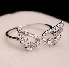 Check out this item in my Etsy shop https://www.etsy.com/listing/215769960/fashion-angel-wings-opening-ring-unique