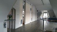 Balcony room long shot away from bar showing door and plain wall