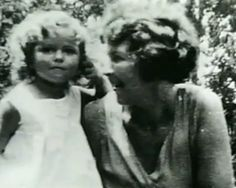 Shirley Temple and her mother, before fame.  She called her mother Mum, she was German.  Pretty lady and child