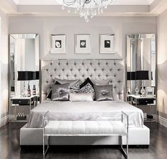 Silver and grey glamour bedroom. Love the vertical mirrors flanking the bed