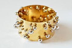 Pol Bury - White gold balls on both sides of a gold bracelet (1999-2009).