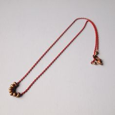 Khaki beads & red chain necklace