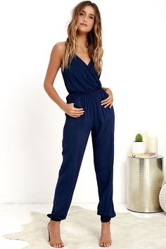 Even if you're too timid for skydiving, the Learning to Fly Navy Blue Jumpsuit will take you on an unexpected journey! This woven jumpsuit is as fun as it is cute, adding adjustable halter ties to a sexy wrap bodice, plus a strip of elastic at back for fit. Cinched waist has hidden elastic, and pocketed pants billow into elastic ankle cuffs.