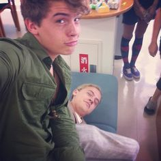 Dylan sitting on Cole Sprouse