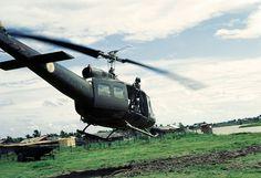 Vietnam War 1967 - A door gunner surveys the area in the Mekong Delta   Flickr - Photo Sharing!