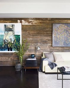 The exquisite barn board feature wall as seen in the Elle Decor ... I ADORE the way the rustic and natural boards make the modern Art and furnishings pop in a clear and beautiful manner.
