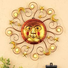 "US $18.36 New in Home & Garden, Yard, Garden & Outdoor Living, Other  Yard, Garden & Outdoor This impressive wall decor features glowing accents, swirling details, shining stars and moons. Hand-painted in warm colors, the sun is surrounded by yellow balls that light with solar-powered light at night. Includes 1 ""AAA"" rechargeable battery. Metal and plastic. 14 3/4""Dia.  $18"