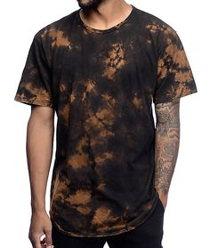 Stay on top of the trend game with the EPTM. Splatter Black OG Black Elongated T-Shirt. The shirt is of elongated design including a rounded hem and features bleached detailing throughout, a nice contrast to the black background. Relatively simple with en