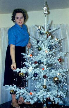 PUTTING TINSEL ON THE TREE