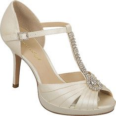 This elegant high heeled shoe features a rhinestone adorned T Strap, pleated peep toe, and a leather outsole.