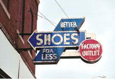 Better Shoes for Less  Granite City, IL  Sign by Levy & Co.    This sign hung for decades on a building on 19th Street, which used to be Granite City's main shopping thoroughfare. In recent years, the city has demolished most of the buildings on one side A huge selection of women's shoes at various price levels, all with Amazon discounts.