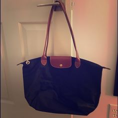 Longchamp nylon tote Large Longchamp foldable tote! A few outside scratches (pictured) but still a wonderful classic bag. Longchamp Bags Totes