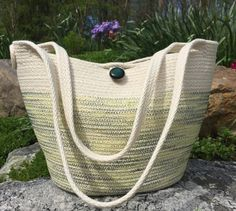 Coiled rope tote. Clothesline coiled & zigzagged with multi-green thread and vintage button. By Andrea.