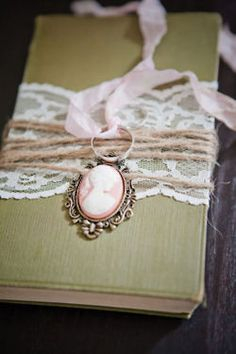 decorating idea with vintage book, lace and ribbon.