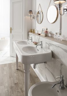 Stunningly sleek taps with a sophisticated double basin for the ultimate luxury look. - Double basin with single lever basin mixer taps in chrome with white levers from Arcade Bathrooms. http://www.arcadebathrooms.com/Products/ProductDetail?prodId=80093&name=Single-lever%20basin%20mixer%20without%20pop%20up%20waste%20-%20nickel%20-%20with%20tap%20handle