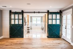 100 year old carriage doors as entry point to master bathroom - by Rafterhouse.