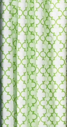 This Moroccan tile pattern brings just a touch of soft-green color to an airy white shower curtain. About $40; Garnet Hill