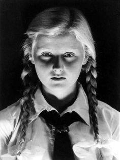 An eerily lit portrait of a Bund Deutscher Mädel girl