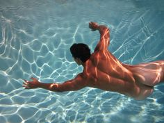 swimming naked in a pool