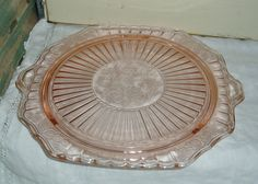 vintage pink depression glass cake plate. $15.00, via Etsy. i love depression era glassware because it comes in such pretty pastels and you can find pretty pieces on ebay or etsy all the time really cheap.
