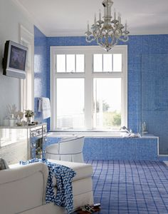 Love the blue tile, the open space and the mirrored vanity in this bathroom!