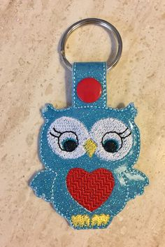 A personal favorite from my Etsy shop https://www.etsy.com/listing/496611692/owl-key-chain-zipper-pull-glitter-marine