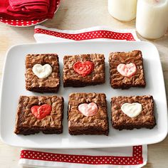 Valentine Heart Brownies Recipe -Steal hearts this Valentine's Day with brownies that have cute frosting centers. They're simply irresistible. —Taste of Home Test Kitchen
