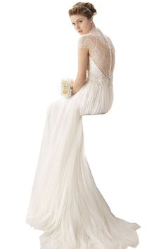 A drop jaw look of elegance for wedding occasion in this cap sleeve long bridal dress from Elliot Claire London. A flowing long formal dress