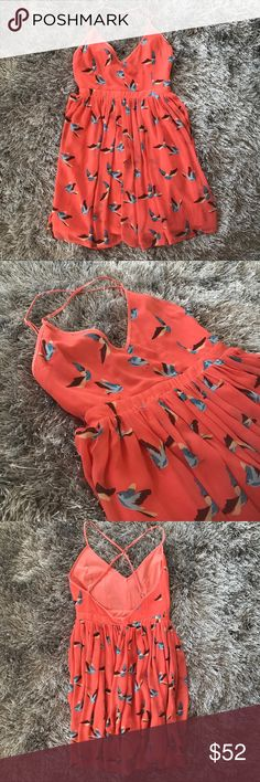 Jarlo Mallory criss cross coral bird dress Jarlo Mallory criss cross coral bird dress. Size small. 100% polyester. Fully lined dress with criss cross adjustable straps. No trades, offers welcome! Jarlo Dresses