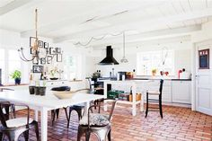 i like how big and cozy this kitchen is. this is really the heart of this home