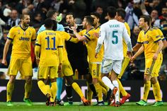 Gianluigi Buffon of Juventus argues with the referee Michael Oliver during the UEFA Champions League Quarter Final scond leg match between Real Madrid and Juventus at Estadio Santiago Bernabeu on April 11, 2018 in Madrid, Spain.