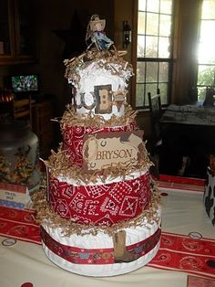 Western diaper cake....so cute I LOVE THIS! Someone have  a baby so I can make this!