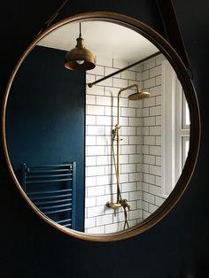 Antique brass showerhead, shower rose, brass industrial light, brass bathroom mirror, white metro tile bathroom, farrow Hague blue, vintage bohemian modern bathroom. House Tour: Our Blue, Brass metro bohemian bathroom