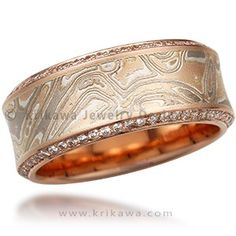 Paved Mokume Wedding Band - This unusual wood-grain metal wedding band has hand-cut pave beading along its edges. The band is slightly concave. Priced with 0.53 carat total weight diamonds or sapphires, and your preferred mokume type.