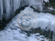 Winter frozen waterfall in the bakony with ice blocks.  In a forest of Farkasgyepű.