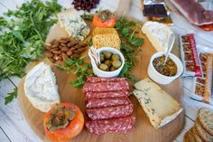 Start assembling your charcuterie and cheese platter from the center and move outward.