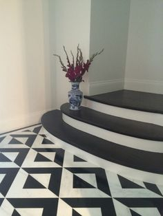Meredith Heron Design #Madison project gorgeous and unique black and white marble tile foyer