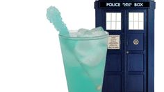 Tardis cocktail  Ingredients:  3oz of gin (2 shots)   1.5oz (1 shot) of Rose's Blue Raspberry Mix  ½ cup Ginger Ale  1tbs Lime Juice  Rock Candy for Garnish  Ice