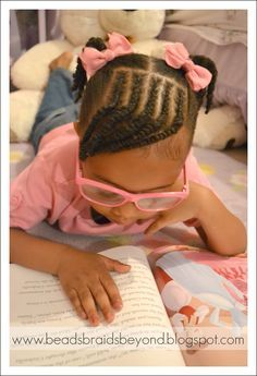 Beads, Braids and Beyond: Little Girls Natural Hairstyle: Cornrows & Twisted Bangs with Pigtails This style doesn't work on my daughter's thick hair.