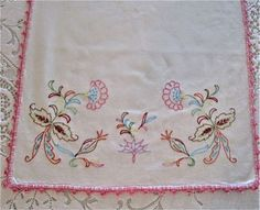 Pretty cottage chic white cotton embroidered table runner with crochet edge.   16 x 38 inches.