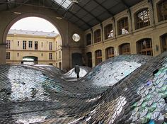 ELISE MORIN & CLEMENCE ELIARD, WASTE LANDSCAPE 2011: 65,000 cds sewn together to cover 500 square meters.