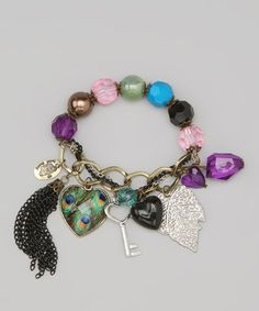 Take a look at this Pink & Peacock Vintage Charm Bracelet by Polka Dotsy on #zulily today!