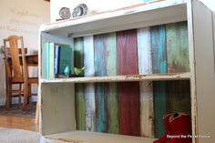Use old fence pickets for bookshelf backing