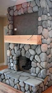 River rock real wood burning fireplace with space for TV above mantle. Wooden Fireplace, Cottage Fireplace, Rustic Fireplaces, Home Fireplace, Fireplace Surrounds, Fireplace Design, Fireplace Mantels, Mantle, River Rock Fireplaces