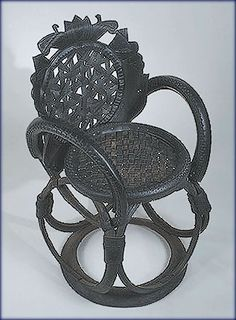 Vintage looking chair made out of used tires.