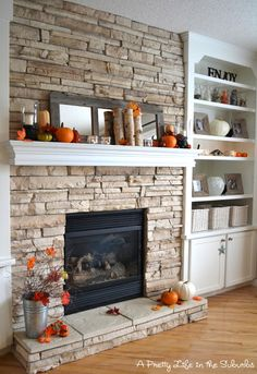 Pretty Fall Mantel:   Let's put shelves and cabinets beside fireplace similar to this picture.