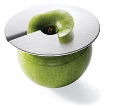Apple Slicer - position this ingenious disc-shaped slicer on any apple and rotate to release perfect slices for snacking or cooking. Don't need a whole apple at once? Just leave the disc pressed against the fruit, and it will not dry out or turn brown. Made of stainless steel. Dishwasher safe.            I WANT THIS.