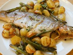 This easy dish roasts all together in the oven: trout, potatoes, asparagus...and dinner is served! #fish #recipe